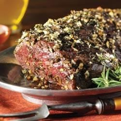 Herb and Garlic Roast Tenderloin with Creamy Horseradish Sauce Recipe - Beef tenderloin is roasted with fresh thyme and rosemary and served with a zesty horseradish sauce.