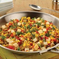 Skillet Corn and Potato Toss Recipe - Diced potatoes, bell peppers, and whole kernel corn are quickly pan fried with onions in olive oil for this quick weeknight or breakfast side dish.