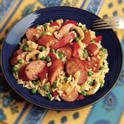 Cheesy Smoked Sausage and Rice Skillet Recipe - Forget the grocery list. Hillshire Farm(R) Cheddarwurst(R) Smoked Sausage adds flavor to almost anything you can pull from the pantry. Serve with broccoli cheese soup, peas and rice for an easy recipe everyone will enjoy.