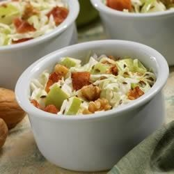 Marzetti(R) Apple Bacon Walnut Salad Recipe - A classic coleslaw mix and Marzetti Original Slaw Dressing give apples, bacon and walnuts their place to shine.