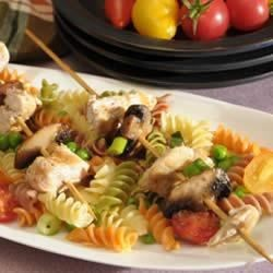 Grilled Chicken Kabobs over Lemon-Scented Wacky Mac(R) Recipe - The perfect paring of grilled chicken kabobs and lemon infused Wacky Mac to create this refreshing dish garnished with pepper and scallions.