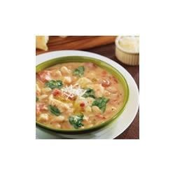 Creamy Tuscan Bean and Chicken Soup Recipe - Simmer white beans, chicken and bacon with cream of celery soup and baby spinach for this hearty, quick, Tuscan-inspired soup.