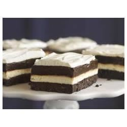 Striped Delight Recipe - Despite its elegant look, this four-layer dessert of cookie crumbs, cream cheese, chocolate pudding and whipped topping assembles in only 20 minutes!