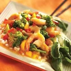 Mandarin Shrimp and Vegetable Stir Fry Recipe - Shrimp is quickly stir fried with garlic, broccoli and peppers, then covered in a spicy orange sauce made with SMUCKER'S(R) Orange Marmalade. This tastes great sprinkled with green onion and served over steamed rice.
