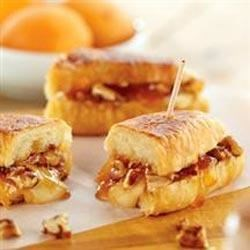 Melted Brie and Apricot Petite Croissants Recipe - For a special brunch treat, fill croissants with brie, apricot preserves, pecans, and brown sugar, and heat until golden brown in a skillet before serving.