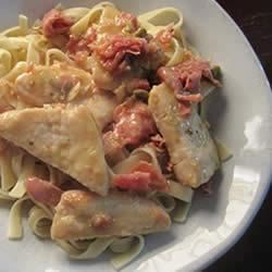 Pork Tenderloin Scaloppine Perugina Recipe - Thin, pan-fried slices of pork tenderloin are served over pasta with a savory prosciutto, sage, and lemon sauce.
