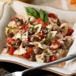 Bowties with Italian Sausage in a Cream Basil Sauce  Recipe - This creamy pasta dish includes red pepper flakes and Italian sausage for a spicy dinner.