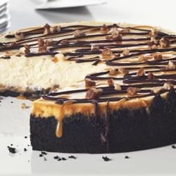 OREO Ultimate Turtles(R) Cheesecake Recipe - When we say 'ultimate,' we mean it. This delectable cheesecake boasts an OREO Cookie crust topped with a nutty layer of caramel and a classic cheesecake filling. Drizzles of melted chocolate and caramel-pecan sauce finish it off in style.