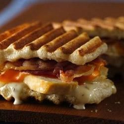 Ranch Chicken and Bacon Panini Recipe - Precooked bacon and cheese are great additions to chicken in these tasty panini.
