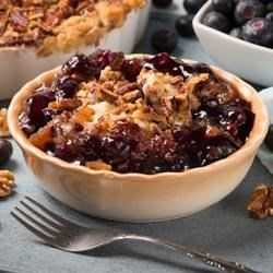 Blueberry-Pecan Crisp Recipe - This simple blueberry and pecan crisp is quick to make thanks to the packaged yellow cake mix. Serve warm, topped with ice cream.