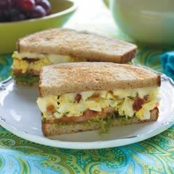 Marzetti(R) Egg Salad Sandwich Recipe - Just like grandma used to make-but better! This recipe calls for hard boiled eggs, Dijon mustard, celery, chives, parsley and bacon.