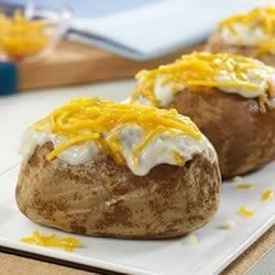 Cheesy Mushroom Potato Topper Recipe - A hearty topping turns a baked potato into an especially tasty side dish. It's hard to believe that something this tasty is so easy to prepare.