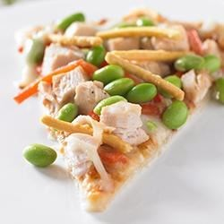 Edamame Asian-Style Pizza Recipe - No need to splurge on take-out when you can whip up this family favorite right in your own kitchen. High in protein and prepared with better-for-you ingredients, this pizza is sure to please!