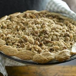 California Walnut Streusel Apple Pie Recipe - This walnut-apple pie has a streusel topping that makes this dessert extraordinary. Serve alone or accompanied with a scoop of vanilla ice cream or a sliver of aged Cheddar.