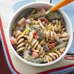 KRAFT's Taco Pasta Salad  Recipe - Give pasta salad a flavourful twist with this easy-to-make whole wheat pasta salad that has fresh spinach, black beans and tomato.