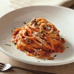 Spaghetti a la Philly Recipe - Your favorite spaghetti sauce gets a delicious make over when combined with cream cheese and cooked ground beef. It's mixed with hot cooked spaghetti for an easy supper.