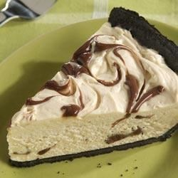 Peanut Butter and Fudge Swirl Pie Recipe - Fudge sauce is swirled through a pie filling of cream cheese, peanut butter and whipped topping in this easy and luscious, no-bake dessert.