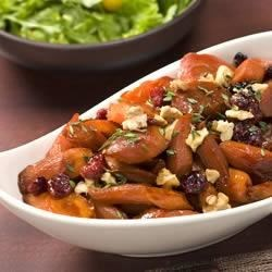 Pomegranate Glazed Carrots Recipe - Sure to be a family favorite, this gorgeous side dish recipe with carrots and walnuts is as tasty as it is beautiful!