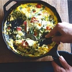 Cheesy Chorizo Frittata Recipe - Crumbled chorizo sausage, spinach, cherry tomatoes, and cheese add heat, flavor, and color to this delicious frittata.