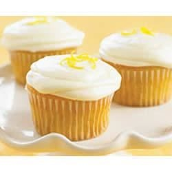 Lemon PHILLY Cupcakes Recipe - Light, lemony cupcakes are frosted with a fresh-tasting icing made with cream cheese.