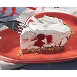 Sweet As Kisses Pie Recipe - Cherry pie filling is swirled through a creamy base and spread with whipped topping in this easy creamy cherry pie.