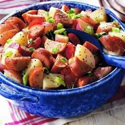 Potato Salad with Smoked Sausage Recipe - Lightly browned smoked sausage, tender new potatoes and fresh garden vegetables are tossed in Dijon mustard vinaigrette for a quick summer meal.