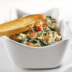 Baked Spinach Artichoke Yogurt Dip Recipe - Low-fat yogurt is the unexpected star in this tasty dip, along with chopped artichoke hearts, spinach, red peppers, green onion and garlic. Mozzarella cheese contains a small amount of lactose, and the live and active cultures in yogurt help digest lactose, making this recipe a friendly option for those who are lactose intolerant.