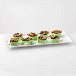 Chocolate Elf Bites Recipe - These chocolate and pistachio fudge squares are simple to make and perfect for the holiday season.