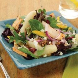 Chicken Pear Salad with Blue Cheese Recipe - Salad greens with blue cheese dressing are topped with chicken, pears, and strips of bell pepper, then garnished with more blue cheese and walnuts for a delicious lunch or dinner salad.