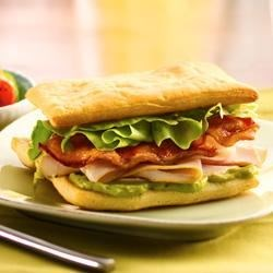 California Crescent Sandwiches Recipe - Build a better sandwich when you bake flaky Crescent dough and stack it with the irresistible combo of turkey, bacon and guacamole.