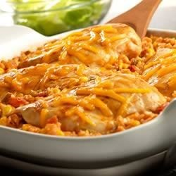 Tex-Mex Chicken and Rice Bake Recipe - This simply delicious and festive dish features Campbell'(R) Condensed Cream of Chicken Soup mixed with salsa, corn and rice, topped with chicken breasts, a dash of paprika and melted Cheddar cheese.