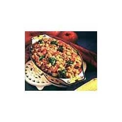 Savory Vegetable Stuffing Bake Recipe - The best way to ensure that everyone eats their vegetables is to combine them with sausage and stuffing in this scrumptious casserole.