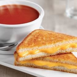 Tomato Soup and Grilled Cheese Sandwich Recipe - A piping hot bowl of your favorite tomato soup served with a grilled cheese sandwich, golden brown and oozing with cheese - now that's a dinner combination that just can't be beat!