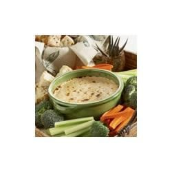 Warm French Onion Dip with Crusty Bread Recipe - Mix together French onion soup, cream cheese and shredded mozzarella and bake for a hot and bubbly crowd-pleasing dip.