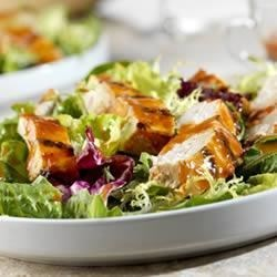 Tomato Asian Chicken Salad Recipe - A bed of salad greens is topped with chicken grilled and basted with an Asian-inspired sauce. Soy sauce, vinegar, ginger and garlic give this grilled chicken its character. Additional sauce is served as a salad dressing.