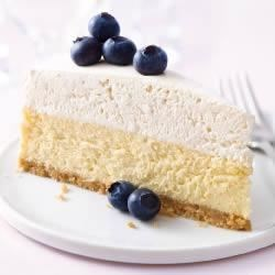 PHILADELPHIA Vanilla Mousse Cheesecake Recipe - After baking, this creamy vanilla cheesecake on a vanilla wafer crust gets a second layer of cream cheese with whipped topping and more vanilla for an elegant, special occasion dessert.