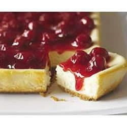 PHILADELPHIA(R) New York Cheesecake Recipe - This classic cheesecake topped with cherries is a special occasion indulgence that will serve a crowd.