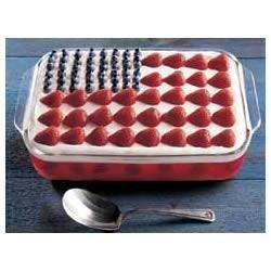 Wave Your Flag Cheesecake Recipe - Salute the red, white and blue with this layered dessert studded with fresh blueberries and strawberries.