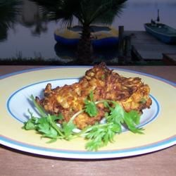 The Best Zucchini Fritters Ever Recipe - This recipe was given to me after smelling them cooking in my neighbor's kitchen while working in the garden. Zucchini is mixed with onion and cheese into some heavenly fritters. I look forward to making them every summer, all summer! You will too!!!