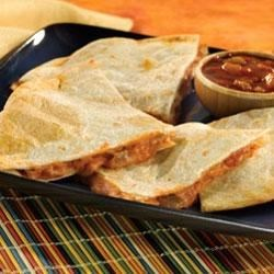 Cheesy Picante Quesadillas Recipe - All you need is 20 minutes and four ingredients to make these tasty quesadillas, oozing with melted cheese and flavored with picante sauce and green chiles.