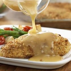 Crunchy Chicken and Gravy Recipe - Crushed dry stuffing mix makes makes this chicken really crunchy and flavorful...and the entire dish is on the table in less than 45 minutes.