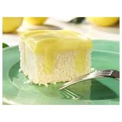 Lemon Pudding Poke Cake Recipe - Lemon lovers will request this sweet and tangy poke cake again and again.