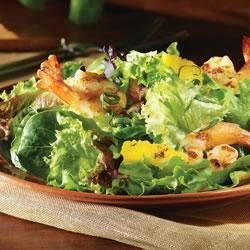 Summer Salad with Grilled Shrimp and Pineapple in Champagne Vinaigrette Recipe - Freshen up your grill with this mouthwatering summer salad recipe from Carapelli Extra Virgin Olive Oil. Made for sharing, this salad is savory, sweet and all-together amazing.