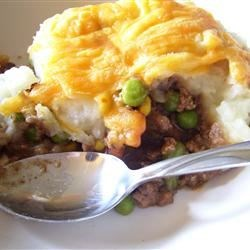 Shepherd's Pie VI Recipe - This easy shepherd's pie is a layered casserole of ground beef and veggies in a homemade gravy. It's topped with Cheddar cheese mashed potatoes.
