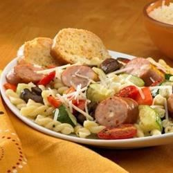 Johnsonville(R) Three Cheese Oven-Roasted Pasta Primavera Recipe - The rich flavor of oven-roasted veggies and sliced chicken sausage are tossed with linguine and topped with grated Parmesan cheese in this fast and delicious one dish meal.
