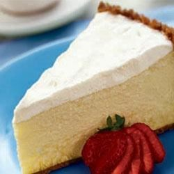 Sour Cream Cheesecake Recipe - A rich cheesecake with the subtle flavor of vanilla is enriched with sour cream.