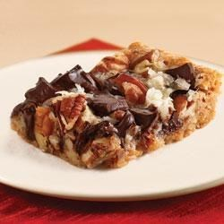 Chocolate Chunk Magic Cookie Bars by KRAFT Recipe - Chunks of chocolate, coconut, and nuts on a graham cracker crust make a great snack bar for after school or with a cup of coffee.