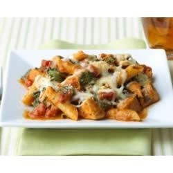 Three Cheese Chicken Penne Pasta Bake Recipe - Multigrain pasta, chicken, spinach, and cheese are tossed with a creamy tomato sauce and baked to bubbly perfection.