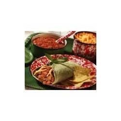Beef 'N' Bean Burritos Recipe - Serve your family this great dish with plenty of napkins: Ground beef, onion and a zesty sauce gets tucked into tortilla wrappers with sour cream, salsa and shredded cheese.