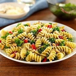 Rotini With Kale, Roasted Peppers and Pine Nuts Recipe - Loaded with flavor, color, and texture, this pasta dish with chopped kale, roasted red bell peppers, pine nuts, and grated cheese makes a great one-dish dinner.